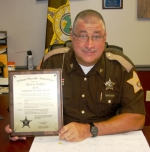 Huntington County Sheriff Terry Stoffel displays his 2015 Sheriff of the Year award. He was presented with the award on Saturday, July 18, by the Indiana Sheriffs' Association. Stoffel has served since 2011 and has worked proactively in the fight against synthetic drugs.