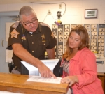 Huntington County Sheriff Terry Stoffel (left) and Shelly Snyder, Huntington County director for the Bowen Center, go over paperwork for the Recovery Works program, an initiative designed to deliver treatment for mental health services to convicted felons who lack insurance.