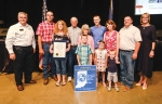 Members of the Simon family celebrate receiving the Hoosier Homestead Farm award Friday, Aug. 9, at the Indiana State Fair. Pictured are (front row from left) Lane Simmons, Maggie Simmons and Worth Simmons;  (second row from left) Lisa Gilbert, Mary Simon, Deborah Simmons, Aaron Simmons and Lt. Gov. Suzanne Crouch; and (back row from left) Director of Indiana State Department of Agriculture Bruce Kettler, Matt Gilbert, Steve Simon and Dwight Simon. The Simon farm is located near Roanoke.