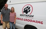 Husband and wife team Greg (left) and Jamie Lambert stand in front of one of two mobile grooming vans they use to take their pet grooming service to their customers. The couple recently moved to Markle and are expanding their service into Huntington County.