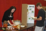 Huntington North High School student Krista Johnson (left) explains how to eat the nopales cactus to an unidentified HNHS student during a fair featuring Hispanic and Hispanic-American culture held Oct. 1 at the high school.