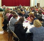 A crowd at the 2014 Purse Blingo intently awaits for the next number to be called. The popular Bingo night, which benefits the Quayle Vice Presidential Learning Center, will be held on Tuesday, April 21.