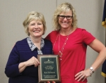 Huntington University President Sherilyn Emberton (left) presents Director of Development Kay Schwob with the school's staff member of the year award.