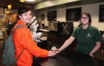 Huntington University junior Hannah Johnson (left), of Decatur, receives the specialty coffee drink she ordered at the university's Starbucks kiosk, served by barista Alyiah Foster, of Huntington. The franchise opened at the university in mid-October.