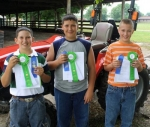 Earning the top honors in the Area XI 4-H junior tractor division are (from left) champion Michael Winters, of Huntington County; second place finisher Elliott Gehres, of Adams County; and third place finisher Brody Norwood, of Huntington County.