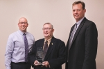 Vincent Haupert (left), Huntington University's vice president for advancement, and Michael Zahn (right), HU Foundation president, honor Rocky Strickler for his 40 years of service as a Foundation board member.