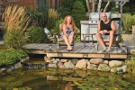 Terrie and Richard Sutton relax in the backyard near their koi pond. Their home, located at 954 Poplar St., is part of the Tri Kappa House Walk tour set for Sunday, Oct. 7.