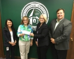 Gwen Burns, Teachers Credit Union Service Center manager (left), and Karol Griffin, president of the TCU Foundation (second from left), present Marcy Hawkins, director of Huntington University's Forester Fund, and Mark Schenkel, HU's director of community relations, with a $2,500 donation.