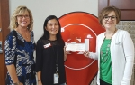 Kay Schwob (left), senior director of advancement operations at Huntington University, and Marcy Hawkins (right), director of the Forester Fund, receive a donation of $2,500 from Gwen Burns (center), Teachers Credit Union Service Center manager. The money will go to help HU students with financial aid for their education.