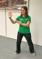 Parkview Huntington Hospital Rehab and Wellness Center Exercise Specialist Katie Cunningham demonstrates a Tai Chi move at the hospital's health and wellness fair, Healthy Steps, in October. The hospital will offer a wellness class in Tai Chi early next year.