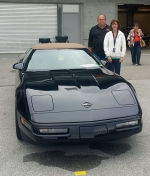 Tom and Suzette Tallman stand next to their black Corvette at the Bloomington Gold show, where the car took the bronze award in the survivor class.