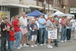Part of the crowd attending the Huntington TEA Party on Saturday, July 4, at the Huntington County Courthouse hold signs and flags as they listen to one of the event's speakers.