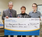 Michael Howell (left), executive director of the Huntington County Community Foundation and Matt Ditzler (right), the foundation's associate director, present Dr. Diana Shenefield, HU's director of nursing/associate professor of nursing, with a check for $30,000 that will be used for the nursing program's technology upgrade.