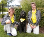 Michele Grimm (left) and Venita Lawyer (right) pose with Ellie, a therapy dog. The team is part of PAWS, which will provide a demonstration prior to Friday evening's concert at the Cottage Event Center, in Roanoke.