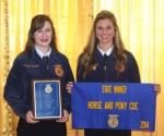 Two of the members of the Huntington North High School state champion FFA horse judging team, Rachel Platt (left) and Jessie Earhart, received the squad's accolades and hardware at the Indiana State FFA convention in mid-June at Purdue University.