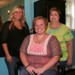 The staff of Twisted Sizzors, located in rural Andrews, is comprised of (seated) salon owner and stylist Stephanie Sunderman; and (standing, from left) stylist Kristan Collins and stylist Jody Foster.