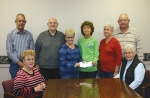 "Celebrating a donation from Union Church to the ""By the Book"" program are (seated, from left) Janet Husband, team leader; and Nancy Beaver, president, Associated Churches of Huntington County; and (standing, from left) Myron Husband, team leader; Dave Stamper, organizer; Sue Stamper, organizer; Kathie Mower, director, ""By the Book"" program; and team leaders Marcia Kline and Harold Kline."