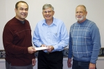 "Rev. Rick Hines (left), senior pastor, Union Church, presents a check for $8,500 to Jack Oberholtzer, president of the ""By the Book"" board of directors. At right is Mark Hoffer, associate pastor, Union Church."