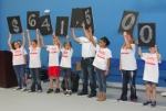 Students in Rachel Smith's fifth-grade class at Lincoln Elementary School hold up signs announcing the 2015 United Way Campaign goal during a skit performed at the United Way kickoff luncheon held Friday, Sept. 25, at the Parkview Boys & Girls Club of Huntington County. Campaign Co-chairman – and principal of Lincoln Elementary – Adam Drummond holds up the comma sign, making sure it's in the right place of the amount of funds United Way would like to raise this year.