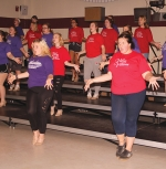 "Members of Viking Volume, the all-female show choir at Huntington North High School, practice choreography on Oct. 22 for the upcoming Pomp and Plenty performances set for Nov. 23 and 24. While Pomp and Plenty has traditionally been a Varsity Singers show, it will also feature Viking Volume this year. The title of the show is ""Just Push Play: An '80s Mixtape."""