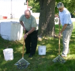Jim Wilson (left) and Rev. Dave Ballinger (right), pastor of Trinity United Methodist Church, roll up walnuts outside the Hoosier Drive-In. Trinity United is collecting walnuts through November as a fundraiser for the Huntington Free Clinic, which is loca
