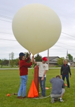 Dillon Gagnon, Austin Gagnon and William Relue (from left) inflate a weather balloon Thursday, May 11, at Crestview Middle School as Crestview science teacher Cheryl Simms watches in the background. Austin Gagnon, a recent graduate of Indiana University-Purdue University Fort Wayne, spearheaded a NASA-funded project at Crestview which culminated with the students launching rockets they had made as well as the weather balloon.