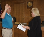 Patrick Scher (left) is sworn into his new position by Shelley Septer, county clerk, as Roanoke Town Council member on Tuesday, July 7, after the bimonthly town meeting adjourned.