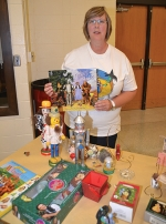 """Linda Glass displays part of her collection of """"Wizard of Oz"""" memorabilia, which will be showcased in the Huntington North High School auditorium lobby during this weekend's presentations of """"The Wizard of Oz"""" by Huntington Theatre Guild: Act II."""