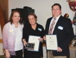 Youth Services Bureau Executive Director Jan Williams (left) presents the 2019 Steven L. Bailey Award to Carla MacDonald (center) and Rev. Steven McPeek, of Trinity United Methodist Church, for their efforts in facilitating the agency's ROCK (Raising Our Children's Kids) program. The award was presented during YSB's annual dinner on Thursday, Jan. 24.