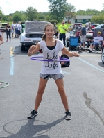 Brooklyn Holley, of Fort Wayne, competes in a hula hoop contest held during last summer's festival car show in Zanesville. The car show will return to Zanesville as part of the Zanesville Lions Club Summer Festival on Saturday, July 29.