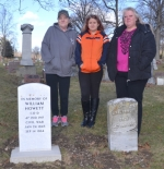 Sally Gamble, Gamble's great-granddaughter Jozine Boyer and Gamble's daughter Jody Cormany (from left) stand behind a recently-installed memorial stone at Mt. Hope Cemetery, in Huntington, for Gamble's great-uncle, William Howett, who died in 1864 during the Civil War. The stone was placed next to the headstone of the grave of Howett's brother, John Howett, who survived his service in the Civil War and died in Huntington County in 1905. The memorial stone for William Howett was installed through the efforts of Gamble's sister, Diana Trivett, a genealogy enthusiast who now lives in North Carolina.