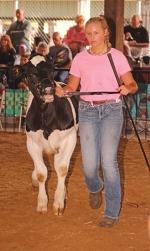 Blake Drasny walks her dairy starter calf inside the Parkview Huntington Hospital Show Arena on July 24, 2019, during last year's Huntington County 4-H Fair. Drasny's calf took champion honors.