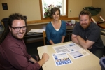 Individuals from the new ALICE community work group discuss the latest ALICE report and ways in which they might assist those in the community who are working hard, yet still struggling financially. Pictured are (from left) Love INC ministry coordinator Kyle Metzger, United Way of Huntington County executive director Jenna Strick and Love INC executive director Joey Spiegel.