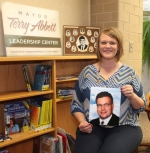 Lincoln Elementary School Interim Principal Ashley Ransom holds a photo of former Huntington Mayor Terry Abbett inside the new Terry R. Abbett Leadership Center, located inside the school's library. The center, which is still under construction, will be unveiled during an awards presentation set for May 5 at 6 p.m.