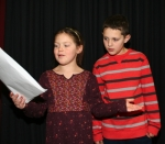 "Emily Albertson and Chase Drummond go over a scene from the Huntington Theatre Guild Act II's Readers Theatre production, ""Love,"" during rehearsal Thursday, Jan. 29. The play, featuring a cast of at least eight children and adults, takes place Saturday, Feb. 14, at the Evangelical United Methodist Church. Albertson is the daughter of Jeff and Deanna Albertson, and Drummond is the son of Adam and Tiffanney Drummond, all of Huntington. Photo by Rebecca Sandlin."