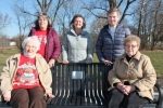 The women of the Altrusa Club show off the park bench they recently donated to the grounds of the Erie Trail, near the Erie Railroad Bridge, on Saturday, Dec. 2. Pictured are (seated from left) Carol Strickler and Juanita Buzzard; and (standing from left) Mary Ruthi, Robin Baker and Midge Decker. Not pictured is the remaining member, Ann Spahr. The club will disband in January.