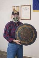 Larry Jenks, of Markle, stands with an American Legion seal that was donated to him by American Legion Post 85 of Huntington. The seal will be displayed in the Indiana Room in the Markle Branch of the Huntington City-Township Public Library.