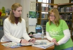 Andrews-Dallas Township Librarian Nancy Disbro (left) discusses prizes for the library's summer children's reading program at the library recently with Friends of the Library President Laura Whiteleather.