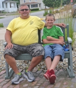 Jason Meier (left) and Connor Huff hang out on the patio of the Huntington Branch of the Huntington City-Township Public Library. They discovered a mutual love of the outdoors after being matched through the Big Brothers Big Sisters program about two years ago.