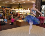 Ballerina Ali Everett, a volunteer at the Huntington City-Township Public Library, performs the dance of the Sugar Plum Fairy for children at the library on Thursday, Dec. 11.