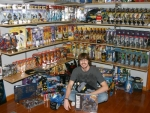 Huntington North High School senior Tyler Miller sits in front of the main part of his Batman collection. He has been a serious collector since 2002, and his family is also involved.