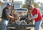 John Brown (left) and Joe Brown pose with Halfway Annie B, the United Kennel Club's  2010 Hunting Beagle World Champion.