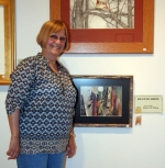 """Cheryl Alevizon, of Warren, won Best of Show in the LaFontaine Arts Council 2010 Regional Art Exhibit. Alevizon's entry, """"Jungle Walk,"""" is a collage inspired by a magazine photo."""