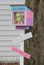 """A box packed with various food and personal care items has been set up in Andrea Storms' front yard, located at 856 Dimond St. in Huntington. The sign invites those in need to take what they can use but leave a """"blessing"""" for others."""