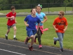 Youngsters race to the finish during Boost Camp, a health and wellness camp organized by Lisa Leist of the Parkview Huntington Family YMCA. Campers exercise, play games and learn nutrition tips during the eight-week long camp.