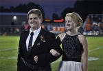 2017 Huntington North High School Homecoming King nominee Robert Borland stands with his sister, Charlotte Borland, during halftime of the 2017 Homecoming game. HNHS homecoming will look a little different this year, as the 2020 parade has been canceled and the number of fans at the football game will be limited.