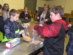 Flint Springs Elementary School students Max Fusselman (left) and Taedan Smelser assemble bags of oatmeal during a trip to the Love In the Name of Christ food pantry on Tuesday, Jan. 31.