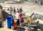 Members of the Huntington University softball team work by a cement mixer during a recent mission trip to Mexico. Pictured in the foreground is Joelle Beals, a sophomore on the team. The following week, members of the HU women's soccer team went on a trip to the same area in Mexico.