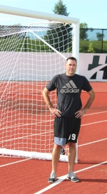 Brad Buzzard, a goalkeeper for the Huntington University men's soccer team, stands in front of a goal on the school's field. Buzzard, 35, was a soccer star at Huntington North High School when he graduated in 1999. Now, years later, he's finally finishing his college soccer career, opting to do so with the hometown Foresters.