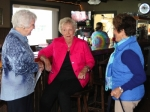 Child Conservation Club members (from left) Nancy Fellinger, Janet Mettler and Mary Machall share a laugh prior to the start of the club's final meeting on Tuesday, May 17, at Lock No. 4 Food and Spirits, in Roanoke. A dozen women attended the luncheon meeting.